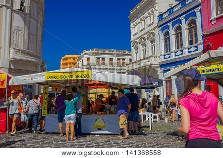 CURITIBA , BRAZIL - MAY 12, 2016: some people buying food in on of the food stands located at the market place.
