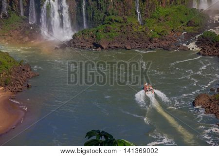 IGUAZU, BRAZIL - MAY 14, 2016: one tourist boat sailing on the iguazu river close to the bottom of the waterfalls.