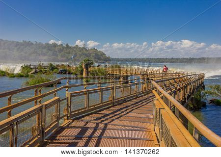 IGUAZU, ARGENTINA - MAY 14, 2016: bridge over the iguazu falls in the argentinian side of the national park.