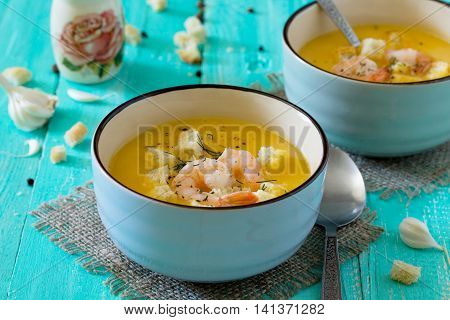 Mashed Vegetable Soup And Shrimp With Garlic And Green Dill On A Blue Background With Vintage Wooden