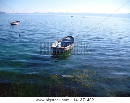 Boat on calm water in Lake Ohrid in Macedonia