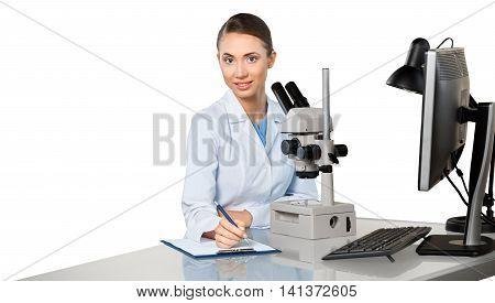 Female Scientist / Researcher / Doctor Using Microscope