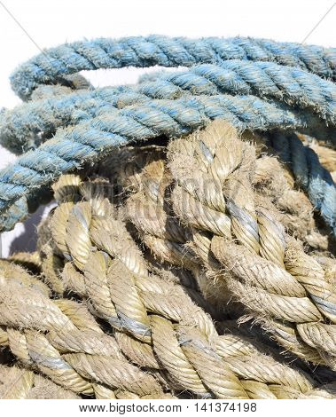 Weathered, old nautical ropes. Stack of ropes, close-up of nautical vessel.