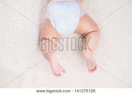 Birthmark on Asian baby girl legs for white background