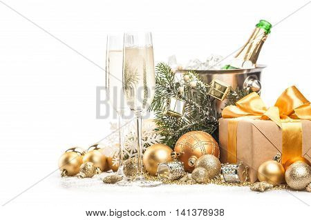 Champagne Glasses and Bottle with Christmas Decorations and Presents
