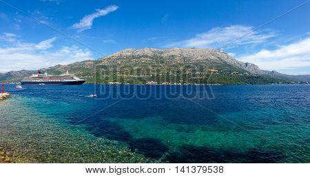 Big cruiser anchored in bay next to Korcula island, Croatia.