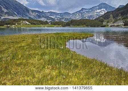 Clouds over Banderishki chukar peak and Reflection in Muratovo lake, Pirin Mountain, Bulgaria
