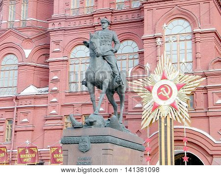 Monument to Marshal Zhukov on the background of the Historical Museum in Moscow Russia