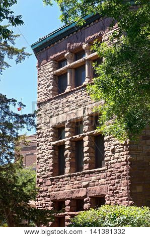 exterior facade of building in old campus historic district listed on national register of historic buildings at university of minnesota in richardsonian romanesque and queen anne architectural style