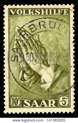 Germany, Saarland - CIRCA 1955: a stamp printed in the Saar, Germany shows painting by Albrecht Dürer, praying hands, circa 1955