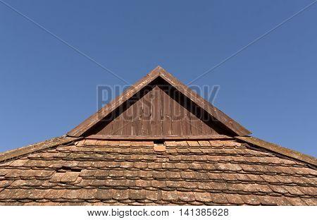 Old Tile Roof Top Against Blue Sky.