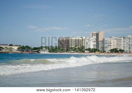 View of Copacabana beach with city skyline of Rio de Janeiro, Brazil.