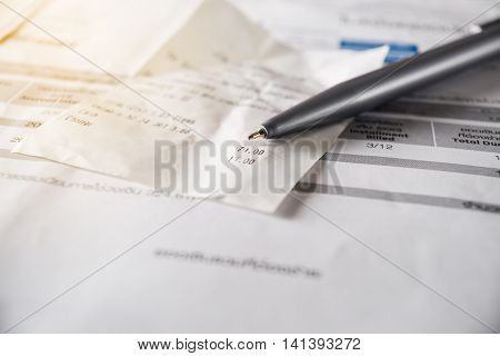 Bill and pen on table Bill for income and expenditure in still life tone