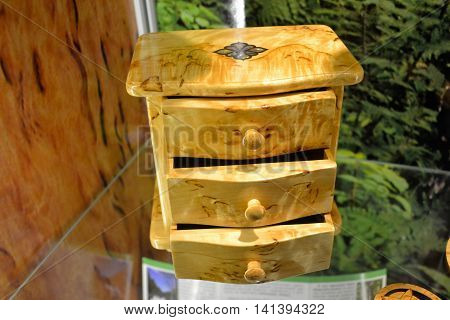 Decorative casket from a birch tree with three drawers