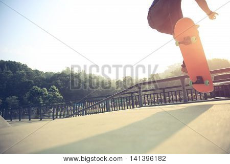 one young skateboarder skateboarding at skatepark ramp