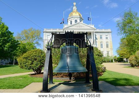 Freedom Bell of New Hampshire in front of New Hampshire State House, Concord, New Hampshire, USA. New Hampshire State House is the nations oldest state house, built in 1816 - 1819.