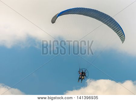 The man floating in the blue sky