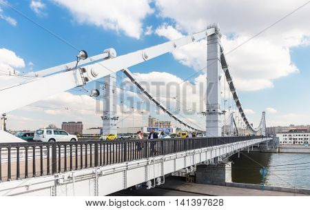 MOSCOW - SEPTEMBER 14, 2015: People walking on Krymsky (Crimean) Bridge. It spans the Moskva River and carries the Garden Ring across the river.