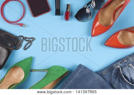 Women Accessories And Different Shoes On Light Background. Top View.
