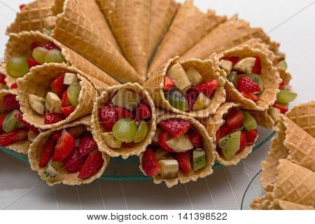 Wafer rolls with ripe berries and fruit filling. Food