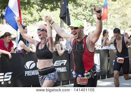 NEW YORK JUL 24 2016: Athletes cross the finish line of the NYC Triathlon Race in Central Park. The run is 10 kilometers and the race is the only International Distance triathlon in the city.