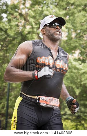 NEW YORK JUL 24 2016: ParaTriathlete competes in the NYC Triathlon Race in Central Park. The run distance is 10 kilometers and the race is the only International Distance triathlon in the city.