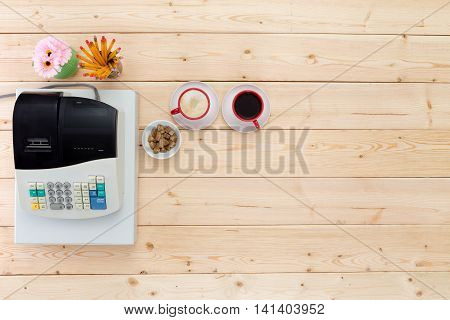 Two Cups Of Black Coffee Alongside A Till
