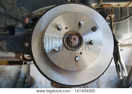 close up on wheel hub and disk brake, car repair
