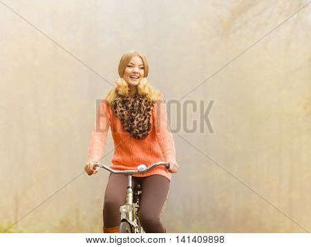 Happy Active Woman Riding Bike In Autumn Park.