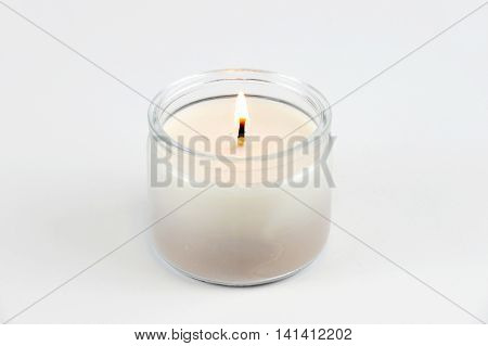 candle flame fire of decorative white candle on white background