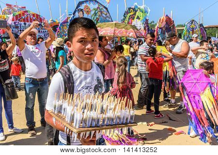 Sumpango Guatemala - November 1 2015: Visitors & sweet vendor at giant kite festival honoring spirits of the dead on All Saints' Day.