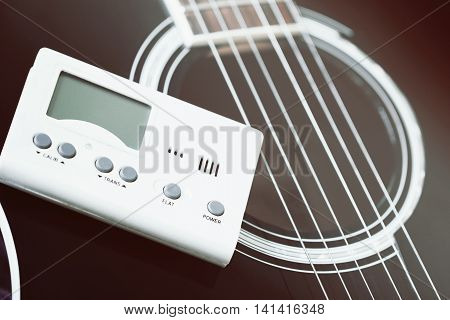 Guitar And Tuner For Musical Instruments