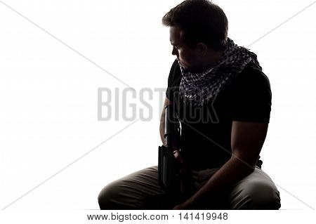 Silhouette of a model as a homesick soldier or veteran suffering from PTSD