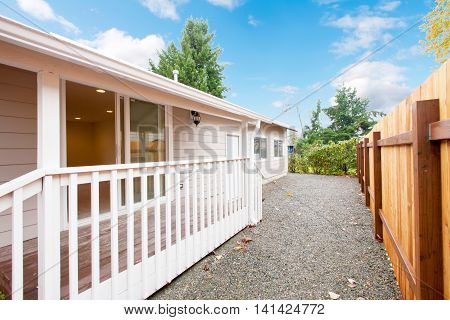 Fenced Back Yard And Small Walkout Covered Deck.