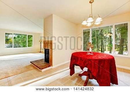 Tile Floor Dining Room Interior With Elegant Red Table Cloth.