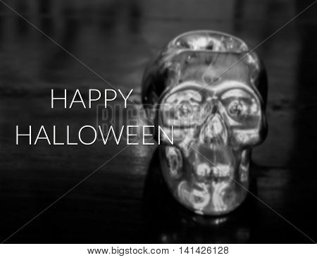 Inspirational quote on blurred silver skull background...Happy Hallowen
