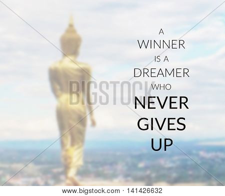 Inspirational quote on blurred background ... a winner is a dreamer who never gives up