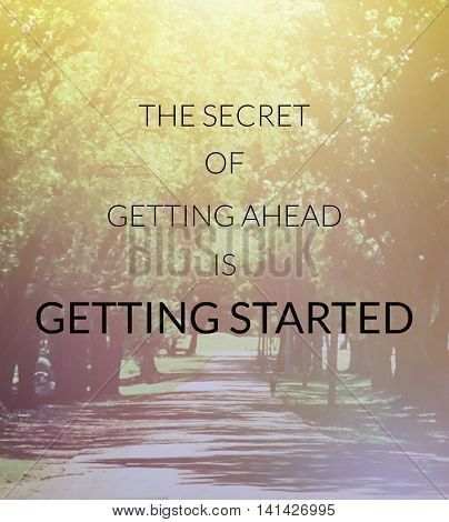 Inspirational quote on blurred background...the secret of getting ahead is getting started