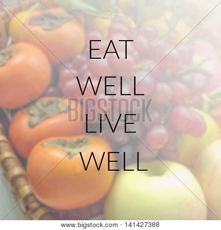 Inspirational quote on blurred background...eat well live well