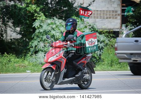 CHIANGMAI THAILAND -JULY 27 2016: Delivery service man ride a Motercycle of The Pizza Company. On road no.1001 8 km from Chiangmai Business Area.