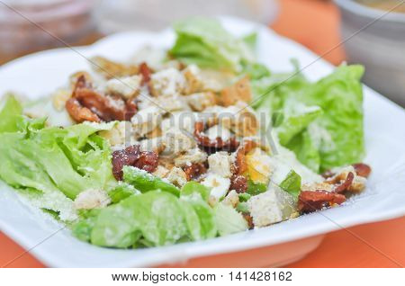 caesar salad or vegetable salad with bacon dish