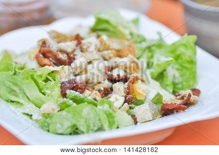 caesar salad or vegetable salad with bacon dish