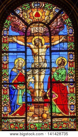 PARIS, FRANCE - MAY 31, 2015 Crucifixion Jesus Virgin Mary Marcy Magdeline Stained Glass Saint Louis En L'ile Church Paris France. Saint Louis En L'ile church built in Notre Dame was built in 1726 on the island in back of Nortre Dame.