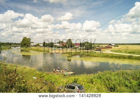 MsteraRussia-August 5 2016: People bathe and repose in river beside villages on August 5 2016 in Russia