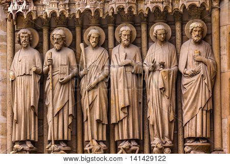 Biblical Saint Statues Door Notre Dame Cathedral Paris France. Notre Dame was built between 1163 and 1250 AD.