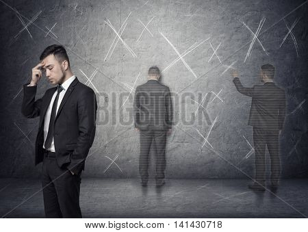 Image of a businessman thinking about how to solve a problem with 'x' marks around him. Process of thinking. Business plan. Economic analysis. Lack of inspiration. Brainstorming.