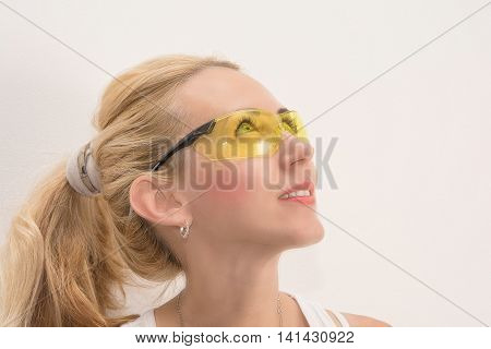 beautiful blonde with safety yellow glasses look