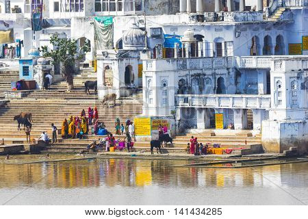 People Wash Themselves In The Holy Lake In The City Of Pushkar, Rajasthan, India.