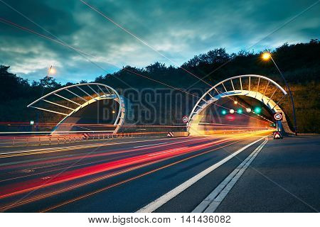 Traffic at night. Lights of the cars and trucks on the highway to the tunnel. Prague Czech Republic