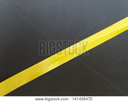 Ribbon of yellow over a black background